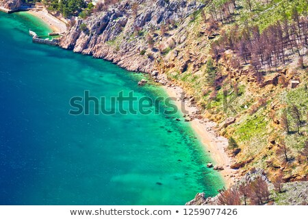 Emerald hidden beach under Biokovo mountain cliffs aerial view Stock photo © xbrchx