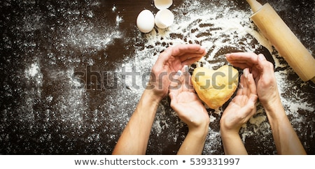 Baker and bread for christmas day Stock photo © colematt