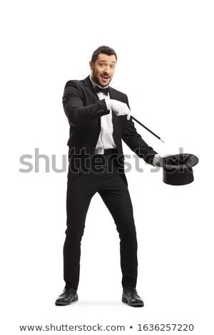 Illuzionista kéz készít trükk fehér kesztyű Stock fotó © ra2studio