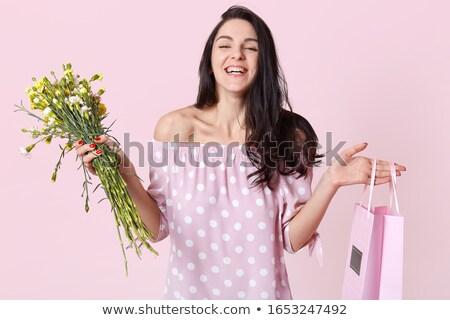 Elegante morena vermelho rosas vermelhas saco Foto stock © studiolucky