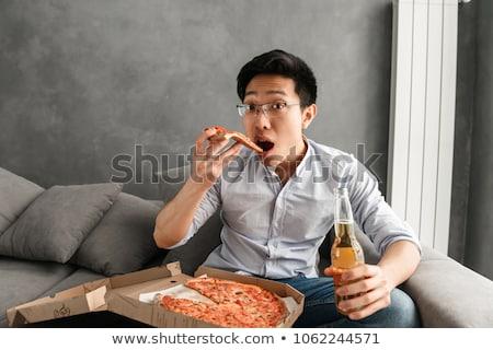 Retrato jovem asiático homem alimentação Foto stock © deandrobot