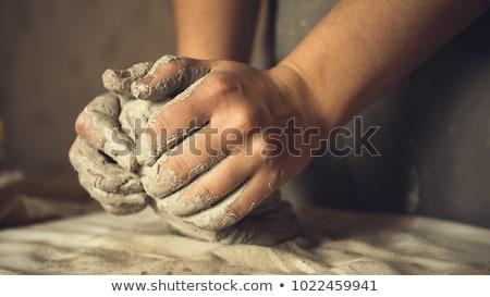 Kneading clay Stock photo © pressmaster