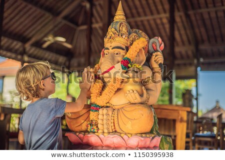 Caucasian boy high-five Ganesha. Meeting Western and Eastern culture concept. oriental and occidenta Stock photo © galitskaya