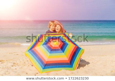Mutter Sohn Strand hat Sonnenschirm Frau Stock foto © galitskaya
