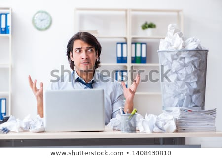 Stock photo: Businessman rejecting new ideas with lots of papers