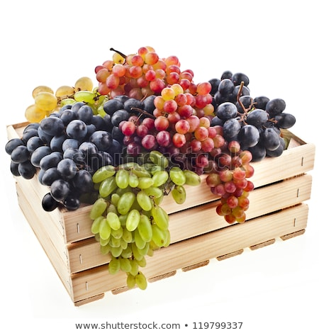 Stok fotoğraf: Wooden Container With Ripe Purple Grapes Isolated