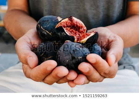 man with some figs in his hands Stock photo © nito