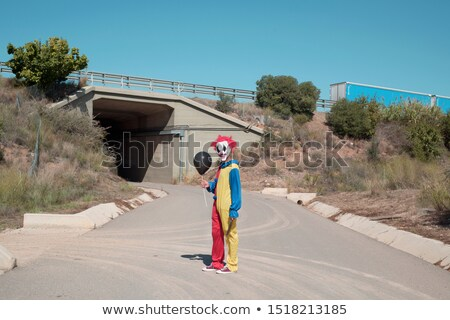 scary clown with a black balloon outdoors Stock photo © nito