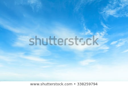 Blue sky background, white clouds and bright sunlight Stock photo © Anneleven