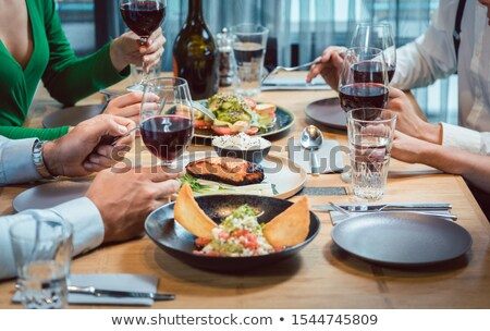 Plate of nice food in a fancy restaurant on table with people eating Stock photo © Kzenon