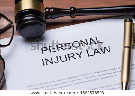 Gavel, Spectacles And Pen On Paper Of Personal Injury Law Stock photo © AndreyPopov