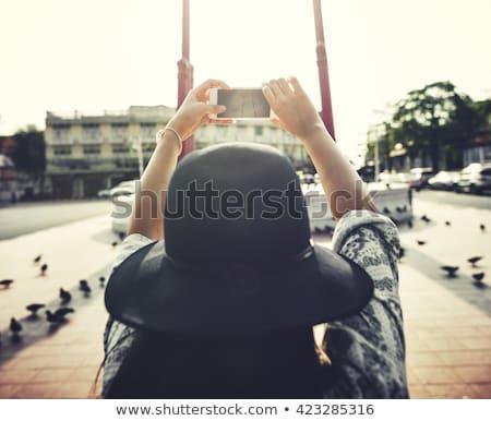 photographer with digital camera shooting in city Stock photo © dolgachov
