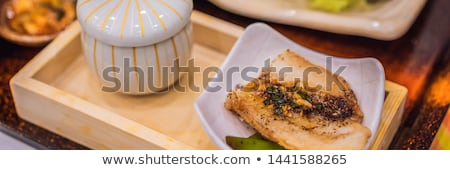 Bento set of prawn tempura and chicken teriyaki in japanese restaurant BANNER, LONG FORMAT Stock photo © galitskaya