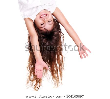 Grappig meisje opknoping ondersteboven witte meisje Stockfoto © Lopolo