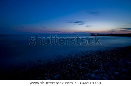 Sunset over the tropical bay. Long exposure shot. Stock photo © moses