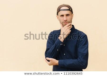 европейский мужчины подбородок рубашку Cap серьезный Сток-фото © vkstudio
