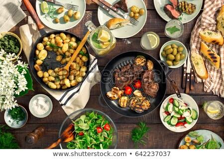 обеденный стол мяса гриль овощей лимонад разнообразие Сток-фото © Illia
