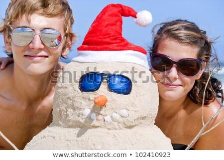 Portrait parfait bonhomme de neige plage sable souriant Photo stock © KonArt