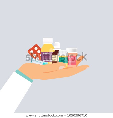 Bottle with tablets on dollars Stock photo © stokato