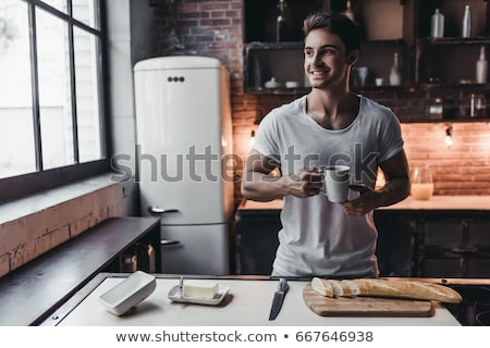 ハンサム · 若い男 · カップ · 茶 - ストックフォト © dotshock