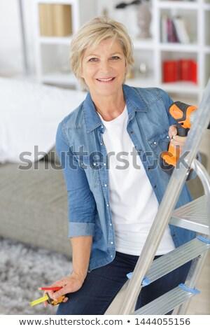 ügyetlen · munkás · mérőszalag · építőmunkás · létra · épület - stock fotó © photography33