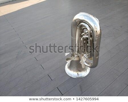 large silver brass tuba on white background stock photo © ozaiachin