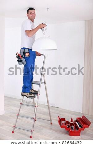 Eletricista teto luz homem casa trabalhador Foto stock © photography33