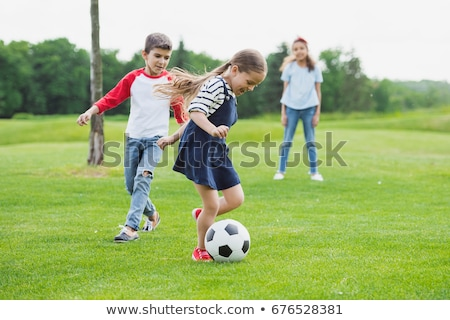 Preteen playing on the grass Stock photo © photography33