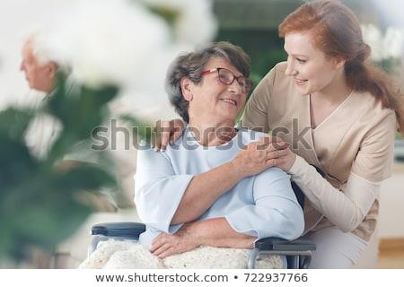 старший Lady коляске улыбаясь женщины за пределами Сток-фото © Melpomene