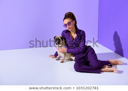 fashion girl with pug dog in studio stock photo © mariematata
