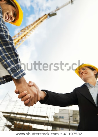 businesswoman greeting a construction worker stock photo © photography33