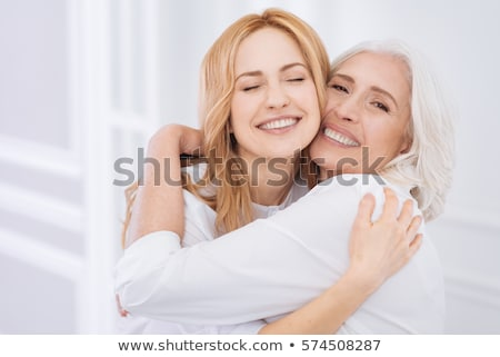Mother supporting her daughter Stock photo © photography33