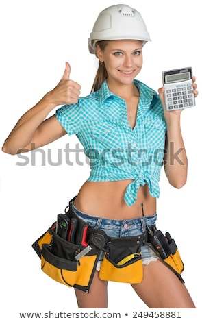 Woman holding spirit-level and giving the thumbs-up Stock photo © photography33