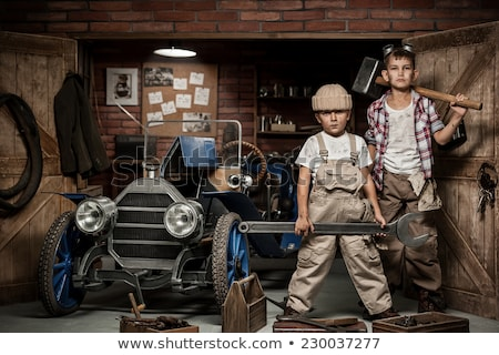 Young worker with a sledgehammer Stock photo © photography33