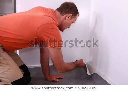 Workman putting down linoleum flooring Stock photo © photography33