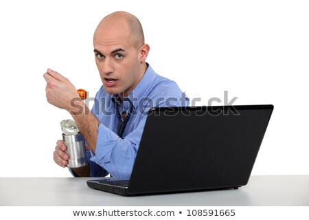 Businessman eating canned food at his desk Stock photo © photography33