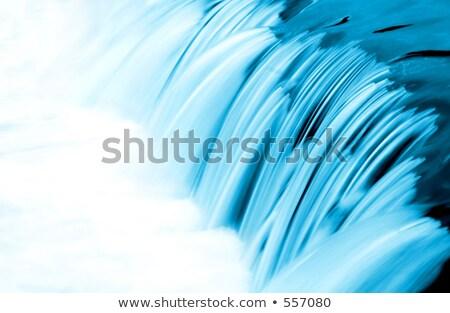 Pequeno cachoeira azul longa exposição água fundo Foto stock © ozaiachin