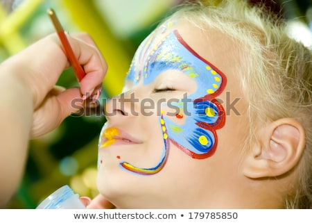 Little Girl With Face Paint Looking Up Stock photo © Kuzeytac