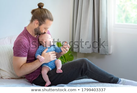cute · nino · cama · familia · hombre - foto stock © wavebreak_media