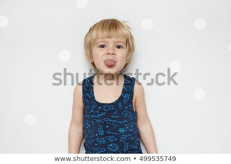 Boy sticking out his tongue against a white background Stock photo © wavebreak_media