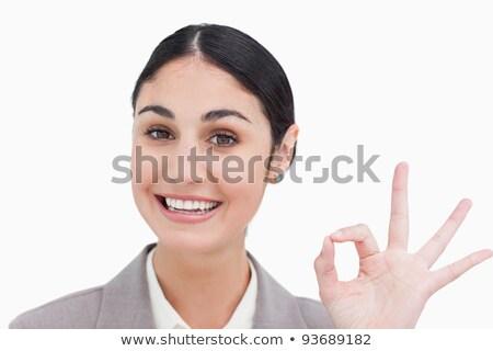 Sonriendo mujer de negocios aprobación blanco trabajador Foto stock © wavebreak_media