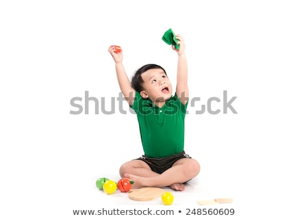 Stock photo: Young school boy excitingly shouts and raise his hand up