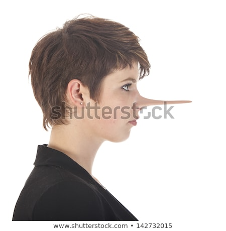 young woman making a lie with long nose isolated on white background stock photo © gigra