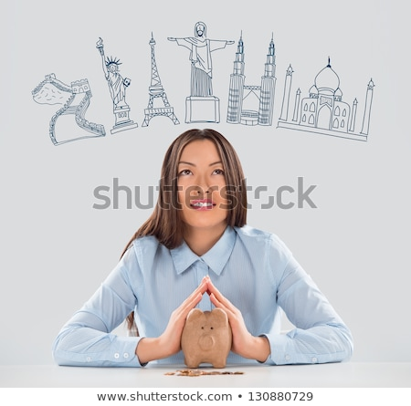Young pretty business woman dreaming about vacation and her trip Stock photo © HASLOO
