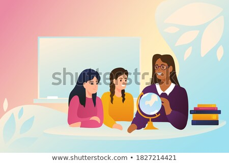 Young girls locating countries on globe Stock photo © stockyimages
