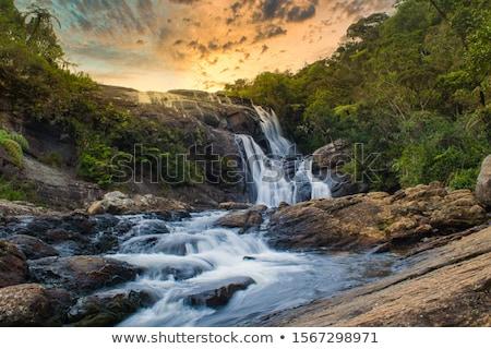 gyönyörű · vízesés · turista · hátizsák · néz · hegyek - stock fotó © Lighthunter