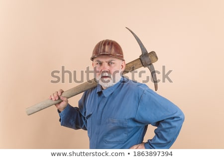 Handyman with a pickaxe. Stock photo © photography33