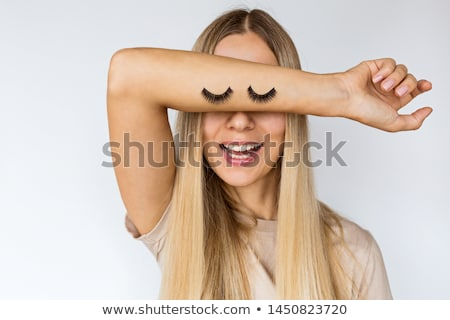 Woman applying mascara on her long eyelashes Stock photo © pxhidalgo