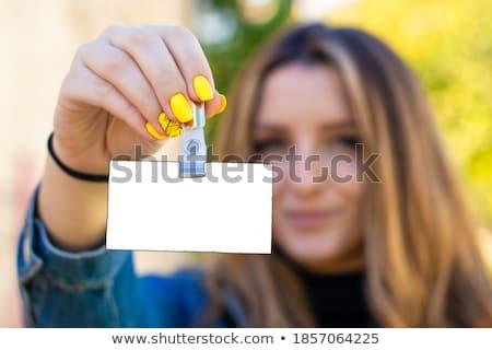 Gyönyörű fiatal barna hajú nő hirdetőtábla mosoly Stock fotó © Nejron