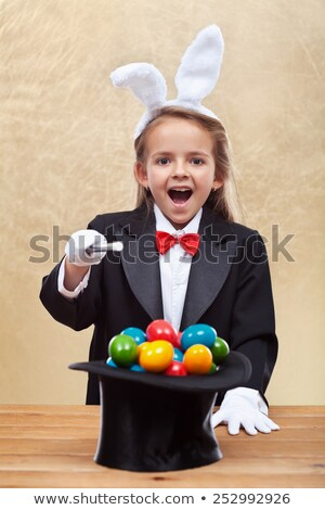 Funny magician girl Stock photo © ilona75